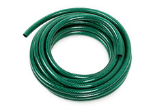 Garden hose. Curled garden hose isolated on white royalty free stock photography