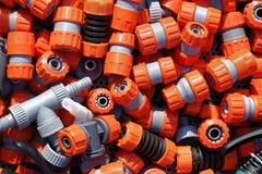 Garden hose fittings. Large pile of plastic garden hose fittings stock images