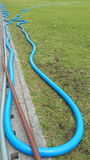 Garden hose on the field. Is a flexible tube used to convey water royalty free stock images