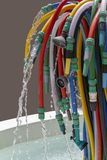 Garden hose fountain. Fountain made of lots of various garden hoses royalty free stock image