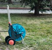 Garden hose. Reeled in the garden royalty free stock photos