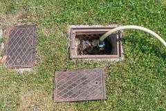 Garden hose irrigation Stock Images