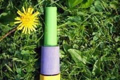 Garden hose nozzle on the grass. Macro shot of a garden hose nozzle laid on the grass, overhead shot stock image