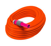 Garden hose with nozzle. Red garden hose with nozzle royalty free stock photos