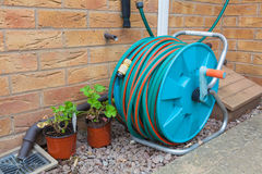 Garden hose reel Stock Photos