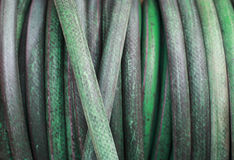 Garden hose on a reel royalty free stock images