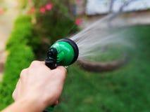 garden hose and spray gun royalty free stock photos