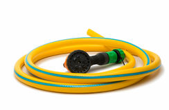 Garden hose with a sprayer Stock Photo