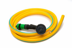 Garden hose with a sprayer. On a white background royalty free stock image