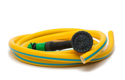 Garden hose with a sprayer Stock Image