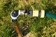 Garden hose with a valve on the lawn. Stock Images