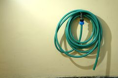 Garden hose and a water faucet Stock Photography