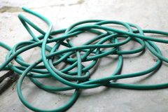 Garden Hose. Hose watering the plants or use it for wash a car royalty free stock photography