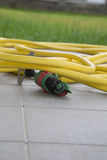 A garden hose for watering Royalty Free Stock Photography