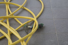 A garden hose for watering Stock Photography