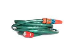 Garden hose on white. Green garden hose on white with sprinkler Royalty Free Stock Image