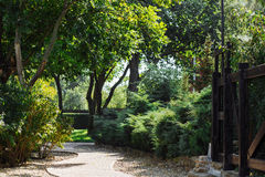 Garden hotel landscape path. English garden hotel summer landscape with green trees Stock Images