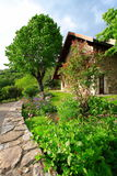 Garden and house 2. Garden in the the french countryside with an old typical house Stock Photography