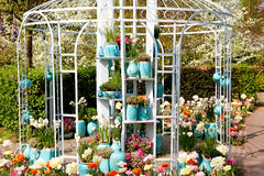 Garden house arbor  with pots and flowers Stock Photo
