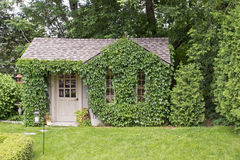 Garden house covered with vines Stock Photography