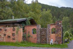 Garden house and garden gate. Located in a mountain valley stock image
