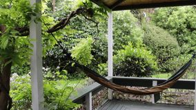 Garden house, hammock in porch stock video