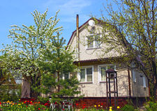 Garden house surrounded by blossoming trees royalty free stock photos