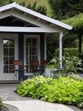 Garden house and terrace with ornametal garden Stock Photos