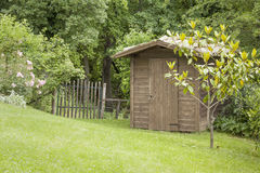 Garden hut and an old gate Royalty Free Stock Images