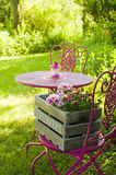 Garden idyll. With table and chairs royalty free stock photo