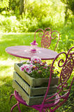 Garden idyll. With table and chairs royalty free stock image