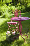 Garden idyll. With table and chairs royalty free stock photography