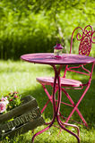 Garden idyll. With table and chairs royalty free stock images
