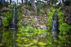Garden with indu statue. Garden with waterfalls and pond, A Hindu statue in the center of the pond idealizes a spiritual corner Stock Photography