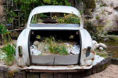 Garden installation with the vintage car. In the garden near Grenoble, France Stock Image