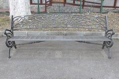 Garden iron bench. An iron bench in a christian church garden Stock Images