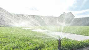 Free Garden Irrigation System Lawn. Automatic Lawn Sprinkler Watering Green Grass. Selective Focus. Royalty Free Stock Photos - 218503598