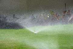 Automatic garden lawn sprinkler, watering the grass. royalty free stock images