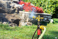 Garden irrigation system watering lawn. Watering sprayer Royalty Free Stock Image