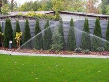 Garden irrigation, working sprinklers Royalty Free Stock Images
