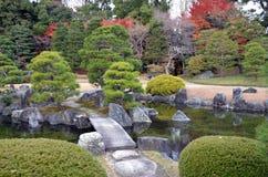 Garden in Kyoto. A garden with a stone bridge in Kyoto, Japan Stock Photos