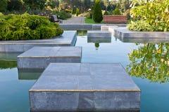 Garden with laguna Stock Photos