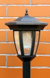Garden lamp. Solar garden lamp on background of the wall stock photography