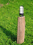 Garden lamp on the background. Of green grass Royalty Free Stock Photography