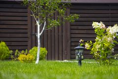 Garden lamp, made in the Middle Ages, on a lawn with a juicy green grass.  royalty free stock photos