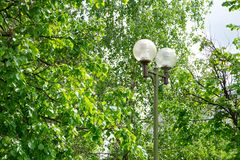 Garden lamp with spherical shades stock images