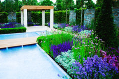 Garden landscape. With decorative pool Stock Photography