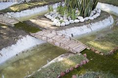 Garden landscape. With bridge and river royalty free stock photography