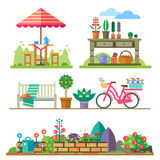Garden landscapes, summer and spring. Picnic, bike, watering can, flower bed Stock Photo
