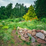 Garden Landscaping Design. Flower Bed, Green Trees Royalty Free Stock Photography